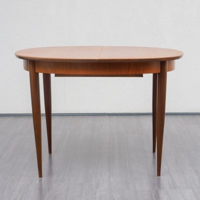Extendable slightly oval dining table in teak, 1960s