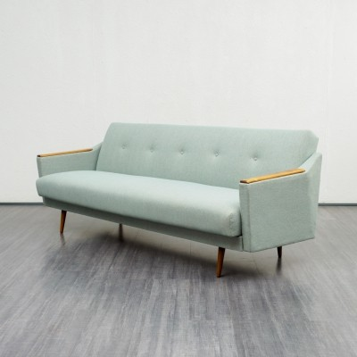 Pale sea green fabric sofa in streamline design