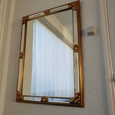 Large gold colored hollywood regency mirror by DeKnudt