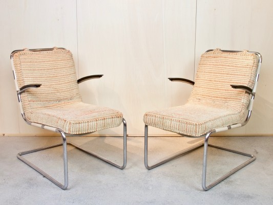 Two no. 411 arm chairs by W.H. Gispen, 1934