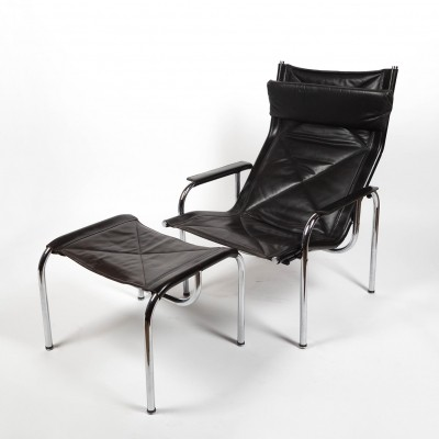 Black leather armchair with ottoman by Hans Eichenberger for Strässle