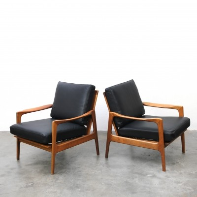 Teak arm chairs with black leather cushions