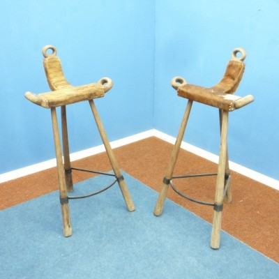 Pair of Brutalist Spanish Cowhide Marbella bar stools, 1950s