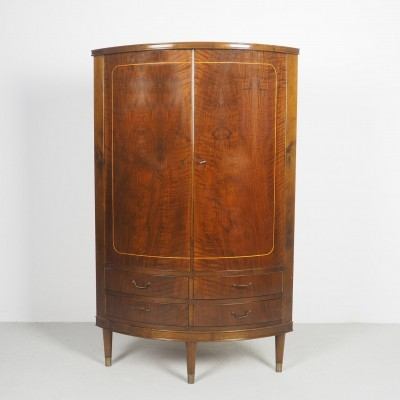 Corner cabinet in mahogany with bowed front, 1950's