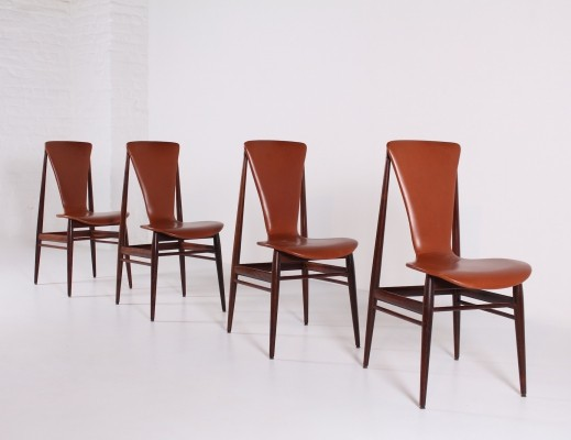 Four rosewood & cognac leather scandinavian chairs