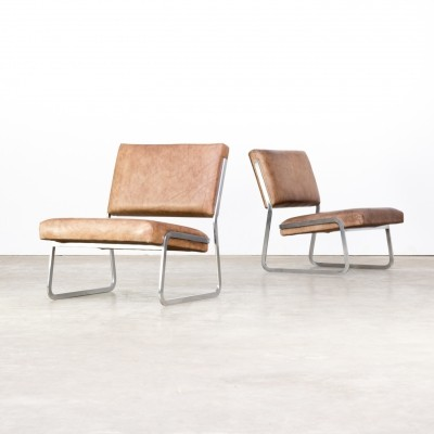Pair of steel framed leather lounge chairs by Paul Sumi for Lübke & Rolf