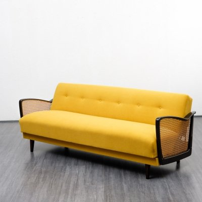 Lovingly midcentury buttercup yellow sofa with fold out bed