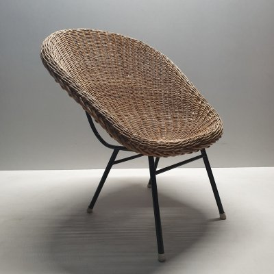 Rattan bucket chair with high back by Dirk van Sliedregt