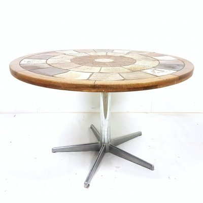 Round dining table on steel star base by Tue Poulsen