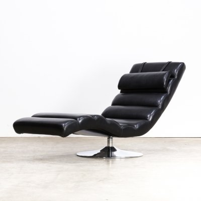 Chaise longue in black skai on chrome swivel base, 1980s
