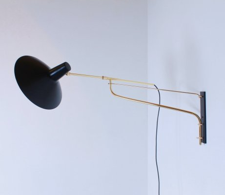 Articulated swinging arm wall light by Artimeta