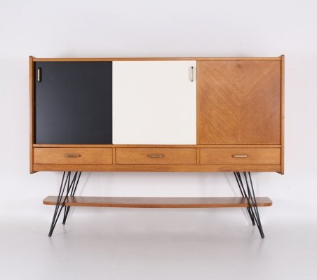 French oak highboard with black & white sliding doors, 1950's