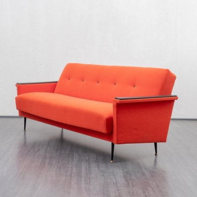 Coral red sofa with fold-out function, 1950s
