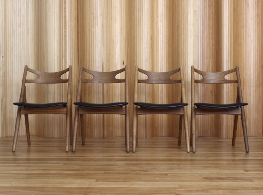 Set of four Hans Wegner model CH29 'Sawbuck' dining chairs by Carl Hansen