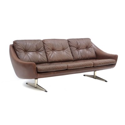 Vintage brown leather sofa with chrome base