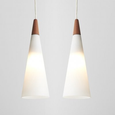 Pair of white cone shaped pendant lights by Holmegaard
