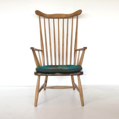 Vintage chair with green cushion