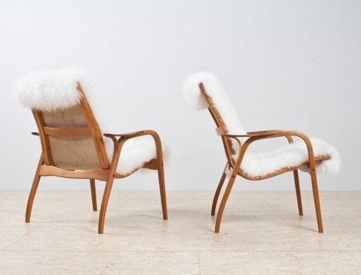 Pair of Lamino lounge chairs in oak & sheepskin by Yngve Ekström for Swedese