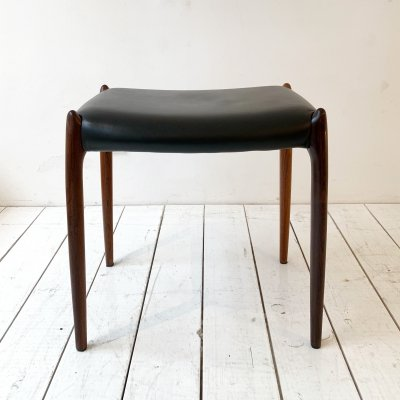Rosewood & black leather stool by Niels Otto Møller