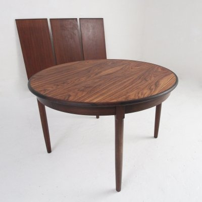 Round Danish Midcentury Dining table in Rosewood with tree extension leaves