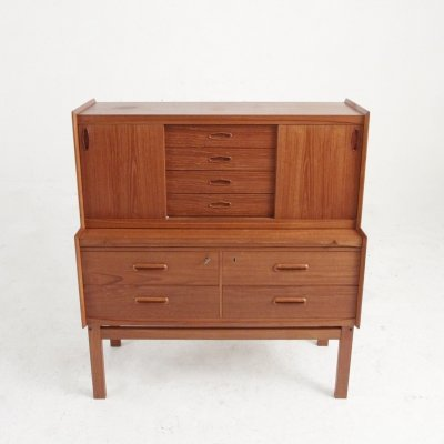 Spacy secretary in teak with two sliding doors, eight drawers & a desk top