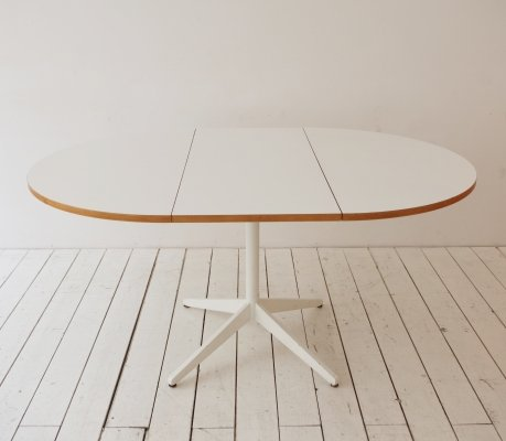 Extending table with white formica by George Nelson for Herman Miller