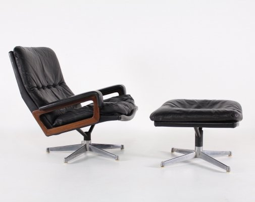 Black leather 'King' lounge chair & ottoman by Vandenbeuck for Strässle