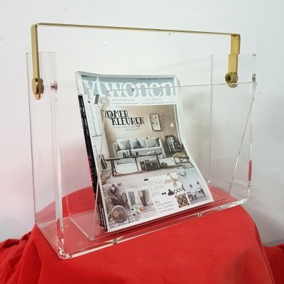 Lucite Hollywood regency magazine holder with brass handle, 1970s