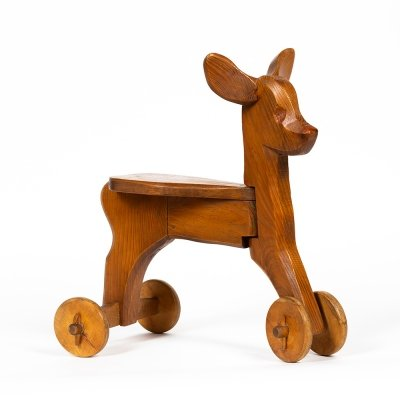 Carved fir tree Little doe on wheels by Antonio Vitali