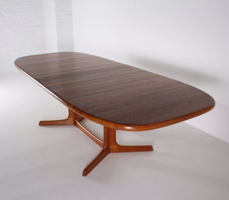 Large danish extensible teak dining table by Dyrlund