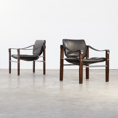 Pair of Maurice Burke black leather 'chelsea' safari chairs for Pozza, 1960s