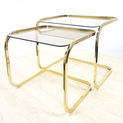 Set of two brass & smoked glass nesting tables, 1970s