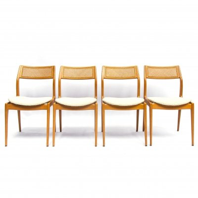 Set of four Danisch midcentury oak dining chairs with a webbing back
