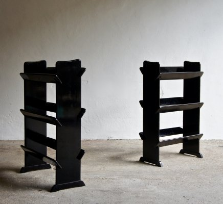 A Pair Of Ebonised Book Shelves