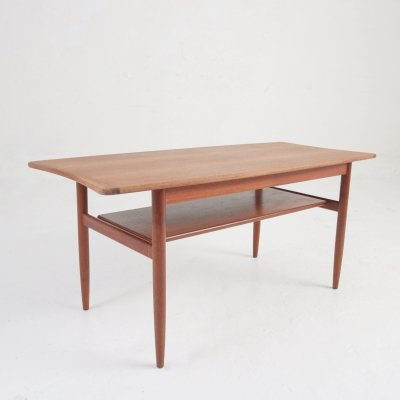 Danish midcentury coffee table in teak with shelf for magazines