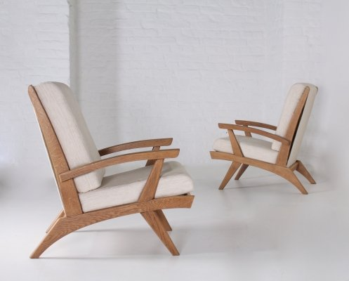 Pair of french oak Free Span 'FS-116' armchairs, 1952