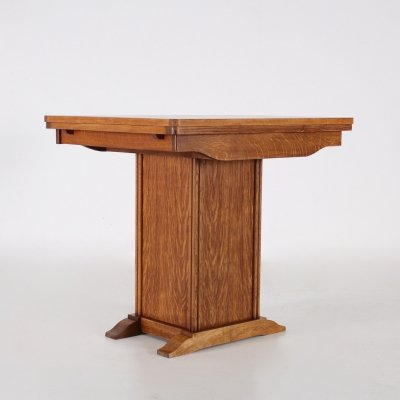 Expendable oak table with hidden compartment, 1940s