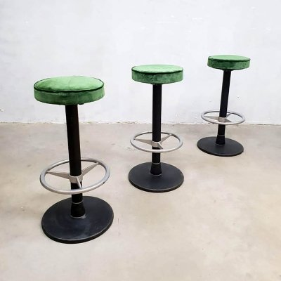 Vintage industrial barstool in luxury green velvet