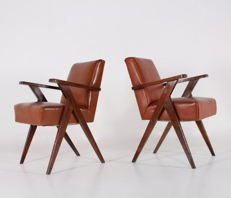 French oak 'compas' shaped armchairs