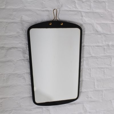 Free form shaped mirror on black glass, 1960's