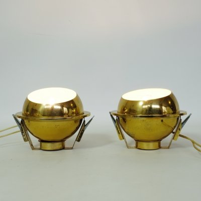 Pair of golden spotlights to be built in the ceiling