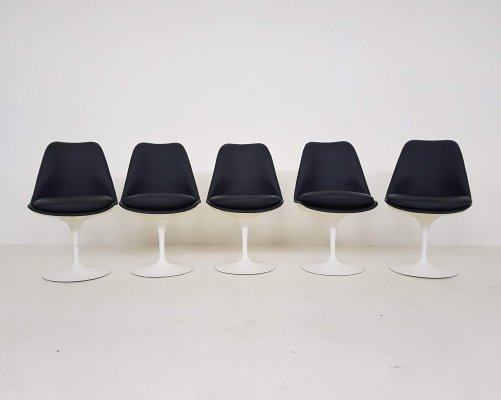 Dark blue leather dining chairs by Eero Saarinen for Knoll