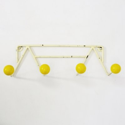 Vintage yellow coat rack from the 1960s-1970s