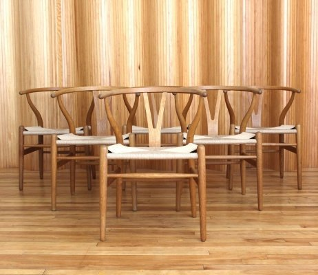 Set of six Hans Wegner oak CH24 'wishbone' chairs by Carl Hansen & Son Denmark