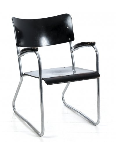 Tubular chair with arm rests by Mauser