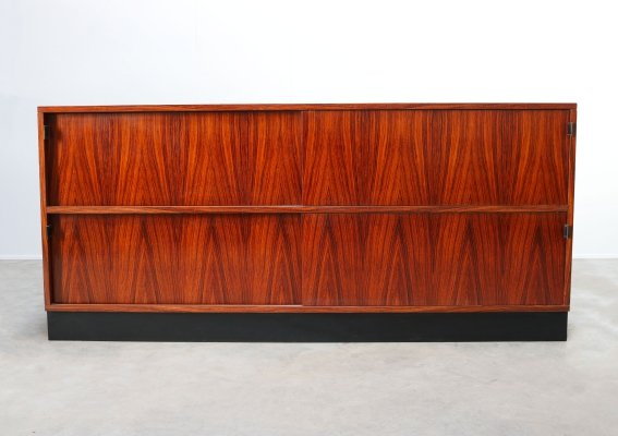 Rosewood sideboard with black leather grips by Florence Knoll for De Coene, 1950