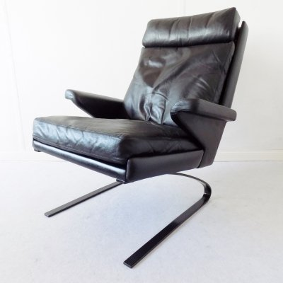 Swing Lounge chair in black leather by Reinhold Adolf for Cor