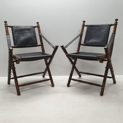 Faux teak leather folding chairs with brass details