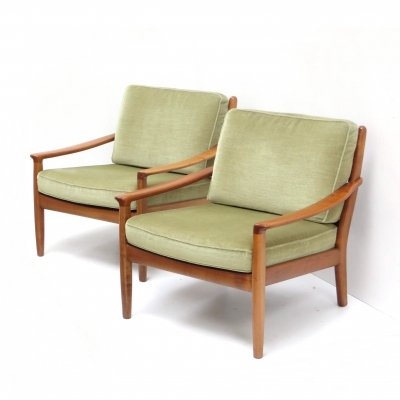 Two vintage arm chairs with green velvet upholstery
