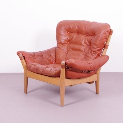 Magnus Olsesen armchair with wood, leather belts & many buttons